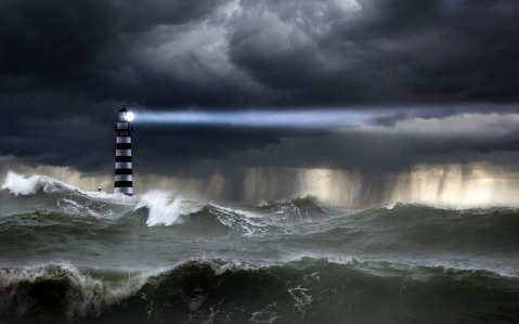 Lighthouse in the Storm. Image Source: wallpaper-kid